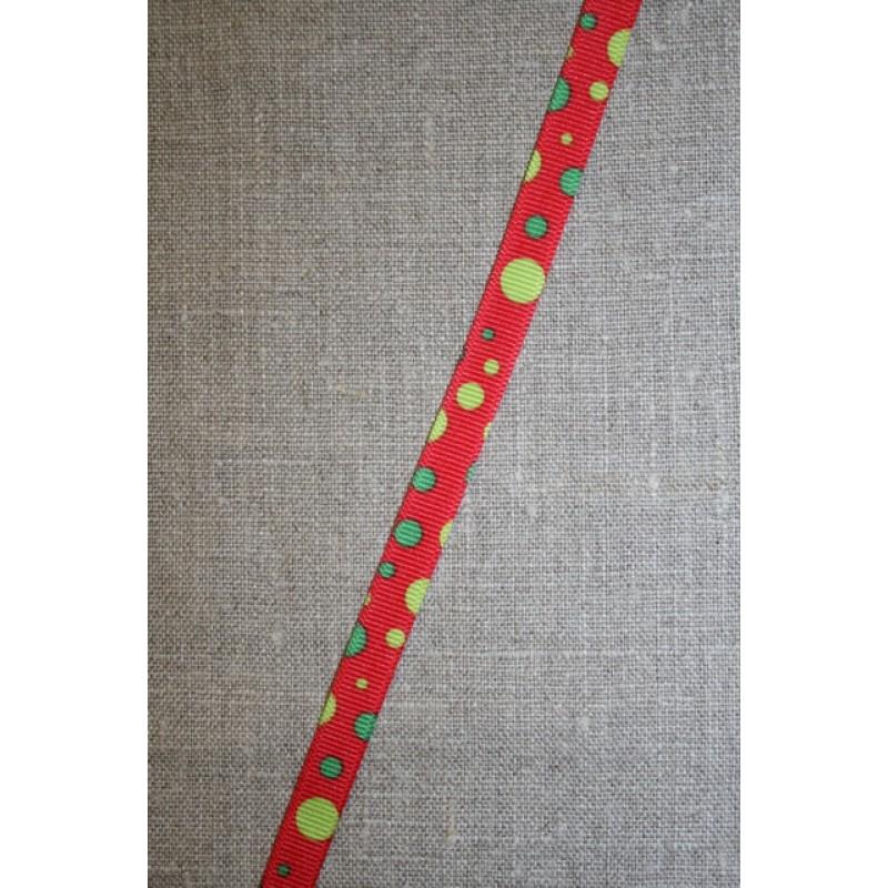 Rødt bånd med lime-grønne prikker