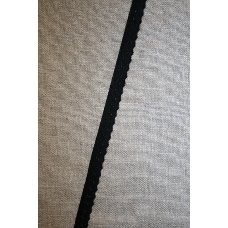 Foldeelastik med buet kant og prik, sort