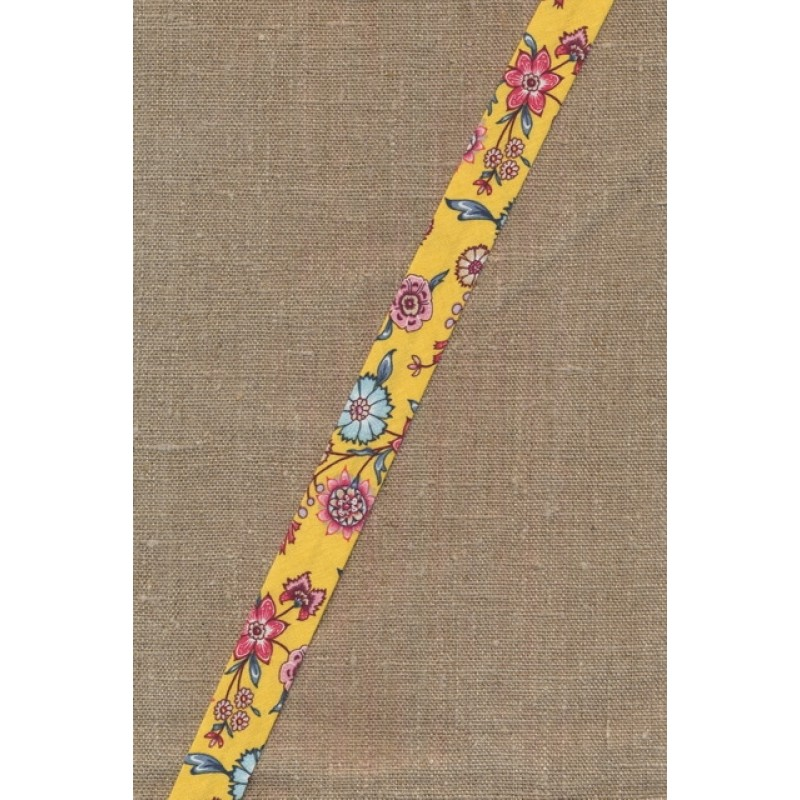 Støvet lys gul skråbånd med blomster