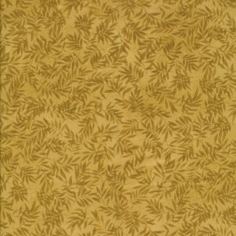 Patchwork stof i gylden med blade