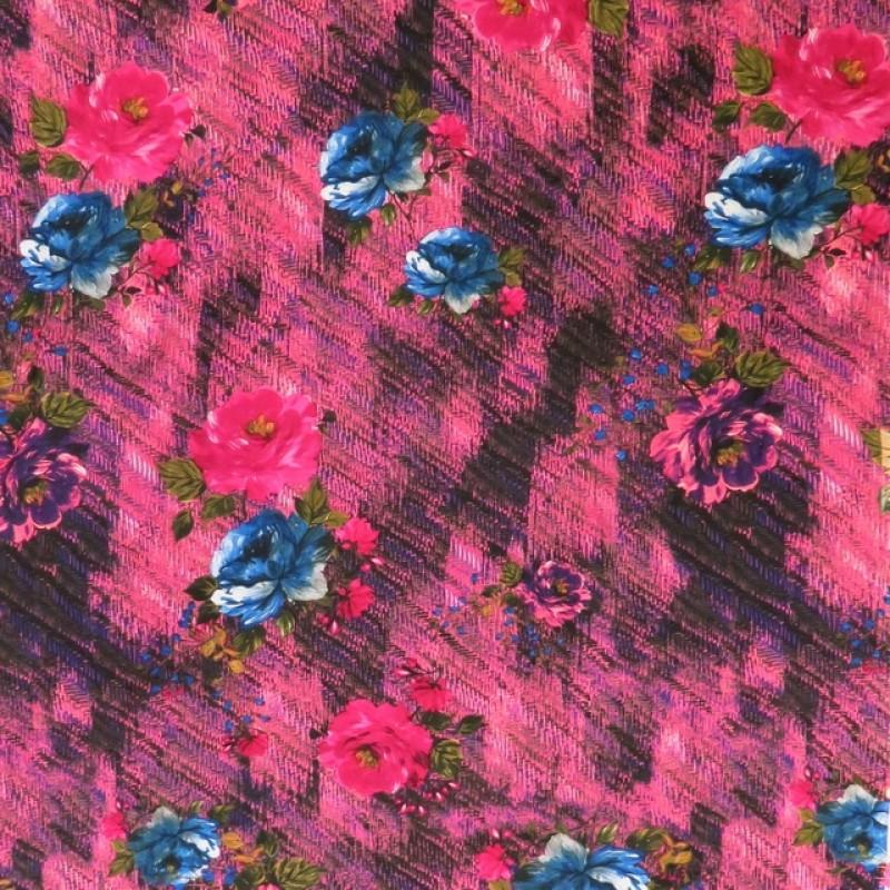 100% viskose med digitalt print i grovvævet look med blomster i pink