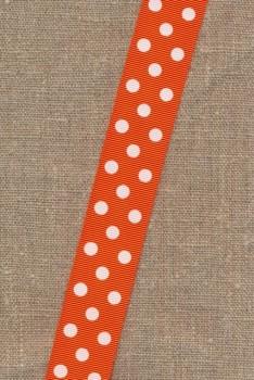 Grosgrain-bånd i orange med hvide prikker, 25 mm.