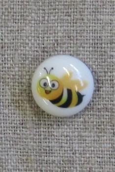 Rund knap i hvid med bi