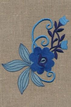 Motiv med blomst i blå