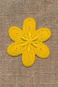 Motiv med blomst i gul