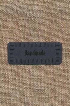 """Motiv i læderlook i grå """"Handmade"""""""