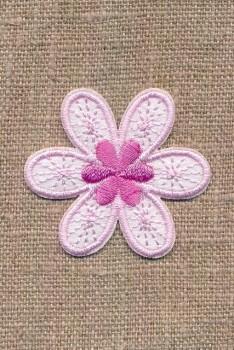 Motiv med blomst i lyserød og hvid