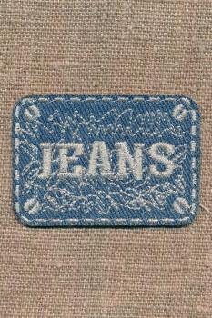Motiv i cowboy med sølv Jeans