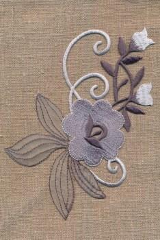 Motiv med blomst i grå