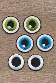 Motiv med 3 sæt øjne
