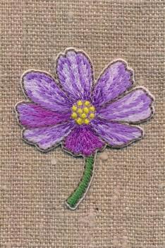 Strygemærke med blomst på stilk i lilla