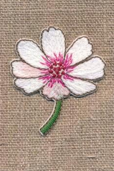 Strygemærke med blomst på stilk i hvid