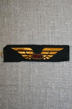 Mærke m/vinge & JET, sort/guld