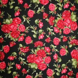 Fast bomuldspoplin med roser i sort rød