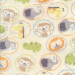 Fleece i offwhite med cirkler med dyr