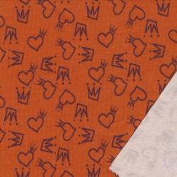 Isoli i støvet orange med hjerter og prinsesse kroner