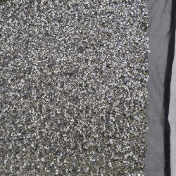Paillet stof i gl.guld og sort på tyl