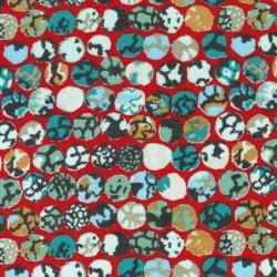 Afklip Patchwork stof af Kaffe Fassett med cirkler i orange, 50x55 cm.