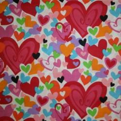 Afklip Patchwork stof med hjerter i hvid, rød, pink og orange 50x55 cm.