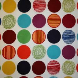 Patchwork stof i grøn, rød og carry med cirkler