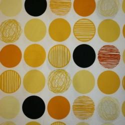 Patchwork stof i gul, carry og sort med cirkler