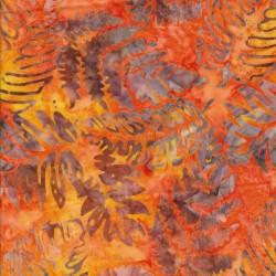 Afklip Patchworkstof batik med blad mønster i orange og gul 50x55 cm.