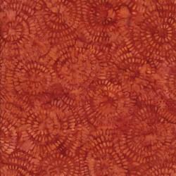 Afklip Patchworkstof batik med cirkler i brændt orange 50x55 cm.