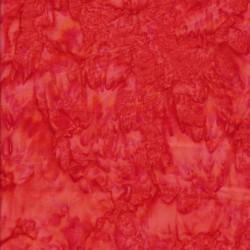 Afklip Patchworkstof batik i rød og koral 50x55 cm.