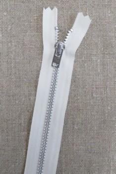 22 cm. metal lynlås i offwhite og sølv - YKK