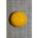 Knap gul i appelsin-look